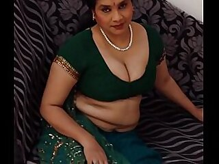 Indian woman clothed on couch
